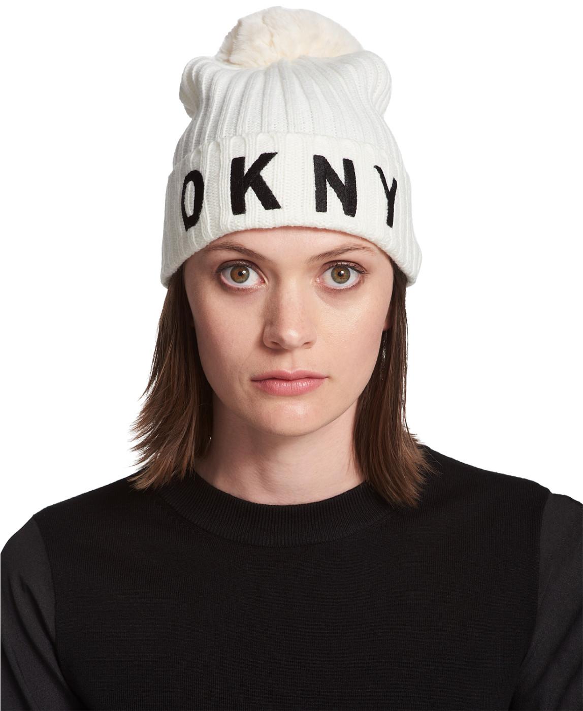 702c4677c DKNY Women's White Ribbed Knit Pom Pom Logo Beanie Hat